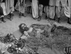 A man lying on thorns.jpg