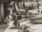 Preparing thatched from coconut palm leaves Kerala 1921.jpg