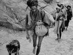 Sadhu with dog in Himalaya 1938.jpg