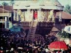 Swamiji distributing prasad.jpg